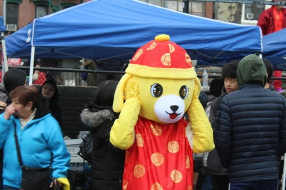One volunteer dressed in a dog costume for the Chinese New Year celebrations.