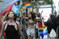 Several protesters dance in front of counter-protesters at The Dyke March.